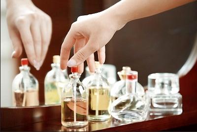 woman selecting perfume